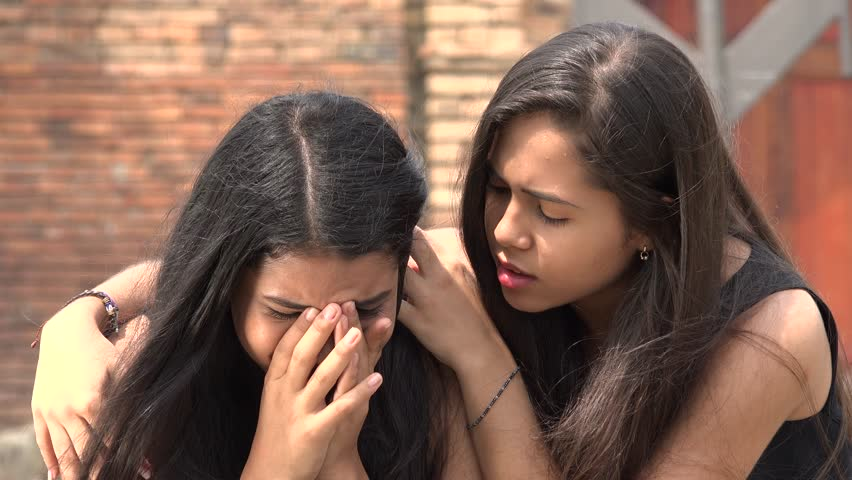 teen comforting crying friend